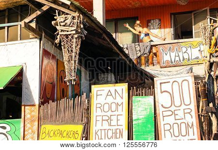 CORON PALAWAN PHILIPPINES - FEBRUARY 9 2016: unidentified woman doing yoga in unidentified backpackers guest house in Coron RP. Coron Town is a traveler destination renowned for scuba diving and sea activities