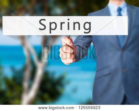 Spring - Businessman Hand Holding Sign