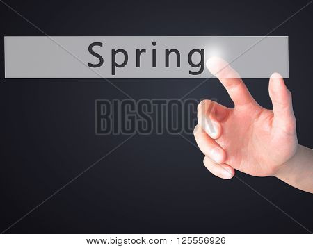 Spring - Hand Pressing A Button On Blurred Background Concept On Visual Screen.