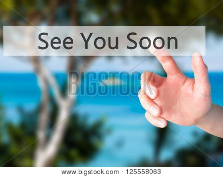 See You Soon - Hand Pressing A Button On Blurred Background Concept On Visual Screen.