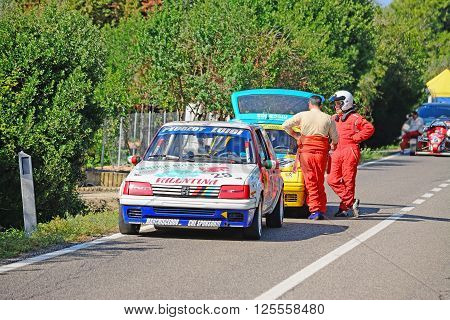 ALGHERO - OCTOBER 18 2015: drivers resting by racing cars during Scala Piccada race in Sardinia Italy