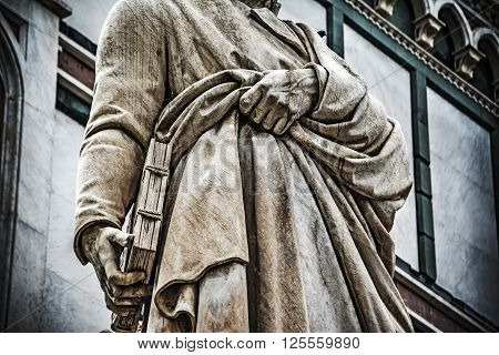 close up of Dante Alighieri statue in Florence Italy