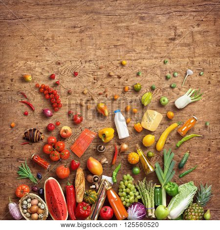 Healthy eating concept. Studio photo of different fruits and vegetables on old wooden table. High resolution product.