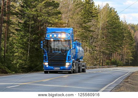 SALO, FINLAND - APRIL 10, 2016: Blue Scania R500 tank truck moves uphill flanked by forest in South of Finland. Scania celebrates 125 years in 2016.