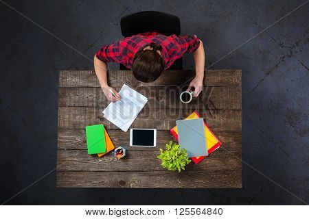Top view creative photo of businessman sitting at dark wooden vintage table. Businessman working with documents