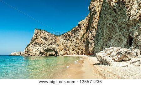 Paradise Beach, Corfu Island, Greece. Paradise Beach is one of the most beautiful beaches in Corfu Island. It is located near Liapades village at south of Paleokastritsa