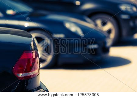 Luxury Cars For Sale Concept Photo. Car Dealer Lot. Parked Cars.