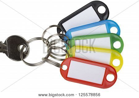 One key with five colorful tags isolated on white
