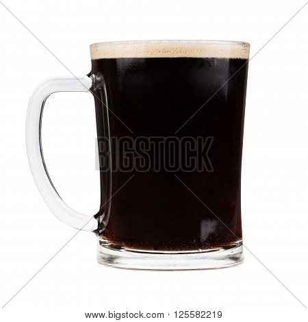 Glass mug filled with dark stout beer