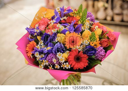 colorful bouquet with different flower composition pink paper