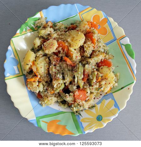Potatos and quinoa meal on a colorful plate