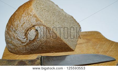 What do You think about bread - and what bread thinks about You? And a peace, and a sword. The knife in the foreground and the bread on a cutting Board, baked in the form of the hieroglyph.