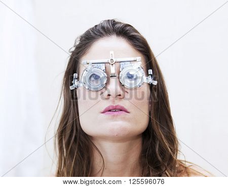 Beautiful Woman Test New Auxiliary Lenses With Phoropter