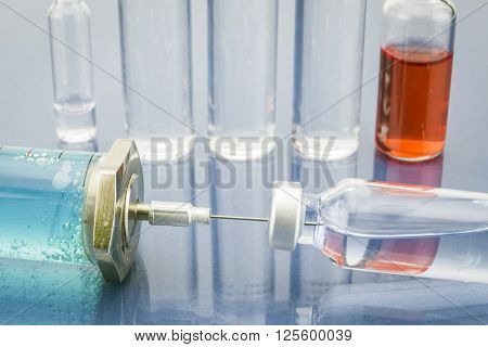 Diagnosis - Treatment and prevention. Medical Report with Composition of Medicaments - Vials Injections and Syringe. Selective Focus