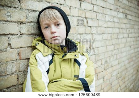 Child In Coat With Dejected Expression