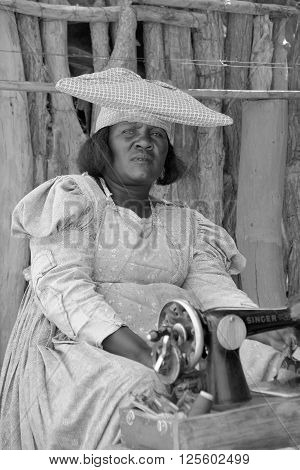 KAOKOLAND NAMIBIA OCTOBER 14: Unidentified Herero Woman in traditional clothes on oct. 14, 2014 near Opuwo. Namibia. The Herero belonging to the Bantu group, with about 240,000 members alive today.