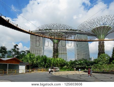 SINGAPORE ASIA -  NOVEMBER 22:  Supertree Grove Gardens by the Bay Nature Park‎ and Marina Bay Sands Hotel November 22, 2014 in Singapore Bay Marina, Asia