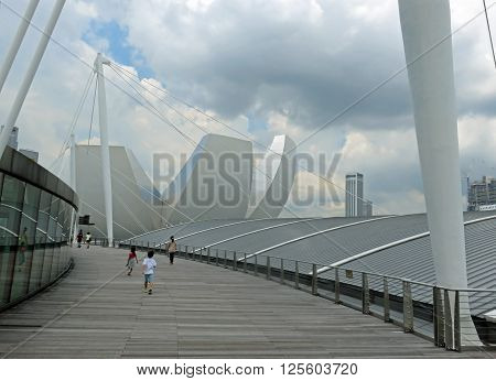 SINGAPORE ASIA -  NOVEMBER 22:  Cityscape of Singapore business district skyline and pedestrian walkway on Jubilee bridge November 22, 2014