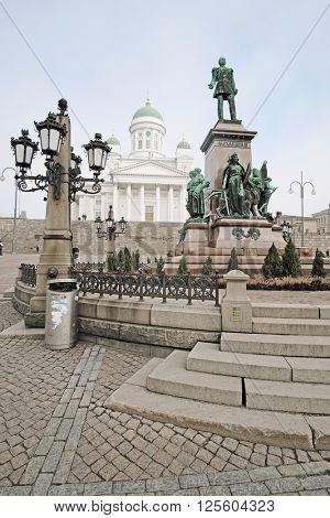 HELSINKI, FINLAND - april, 4, 2016: St. Nicholas Church and a monument of Alexander II on the Senatorial area in Helsinki, Finland.