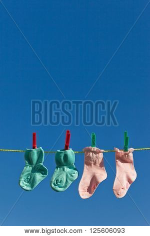 baby socks on clothesline to dry