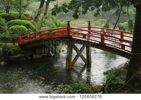 Japanese garden with a red bridge in Japan