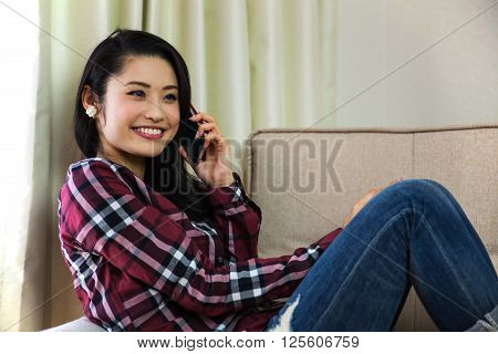 The woman relaxing slowly with smart phone. ** Note: Soft Focus at 100%, best at smaller sizes