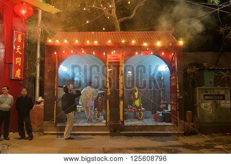 KOLKATA WEST BENGAL INDIA - FEBRUARY 7TH 2016 : Hindu priest praying in front of Chinese Kali statue at famous Chinese Kali temple in Kolkata. Kali is Indian Hindu Goddess as per Hindu myth but worshipped by Chinese of Kolkata also.