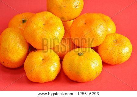 navel orange on red rubber foam board background