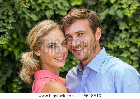 Portrait of happy romantic couple at front yard