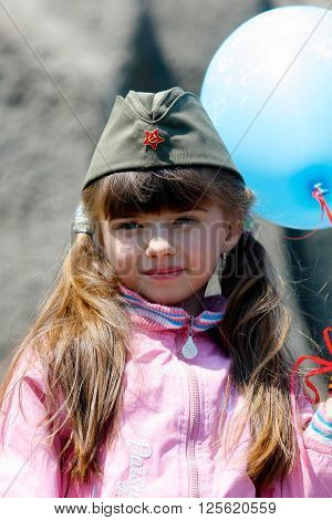 Volgograd, Russia - May 9 2008: A little girl in a military garrison cap on Victory Day celebration on Mamaev hill in Volgograd