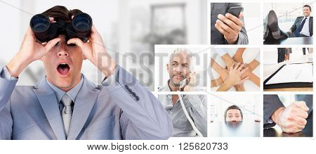 Suprised businessman looking through binoculars against view of a business desk