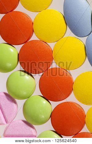 background of colorful varoius kind medical pills.