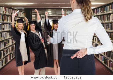 Businesswoman offering handshake with fingers crossed behind her back against entrance of the college library