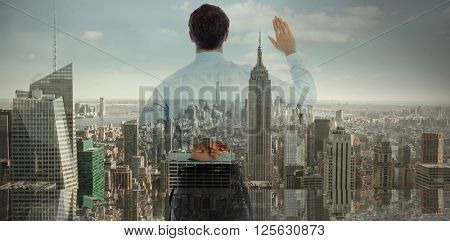 Businessman crossing fingers behind his back against city skyline