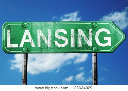 lansing road sign on a blue sky background