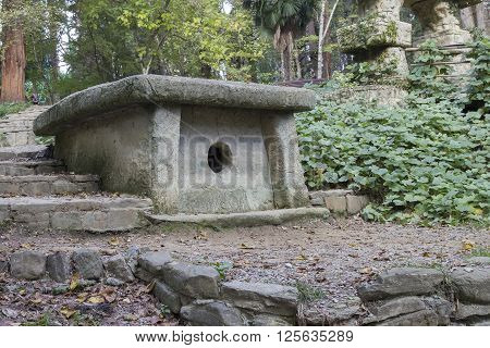 SOCHI RUSSIA - November 07 2015: An ancient Dolmen and a stone ladder in the Tree nursery park wood. Sochi Russia