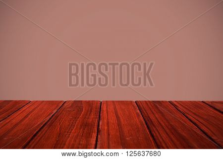 High angle view of hardwood floor against maroon background