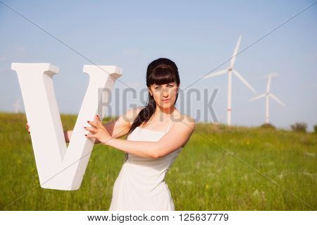 girl on nature with the letter V
