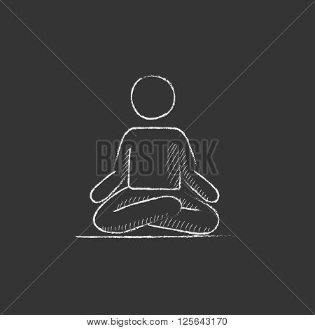 Man meditating in lotus pose. Drawn in chalk icon.
