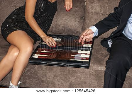 sexy men and women who play Backgammon