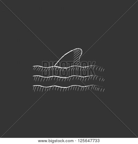 Dorsal shark fin above water. Drawn in chalk icon.