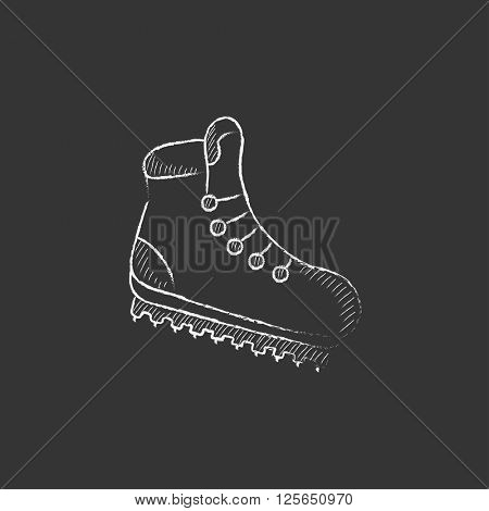 Hiking boot with crampons. Drawn in chalk icon.