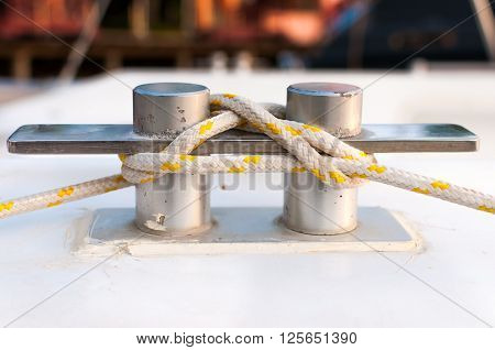 White and yellow stripe rope on the belay at the marina