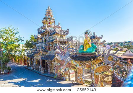 Lam Dong, Vietnam - March 2nd, 2016: Close Pagoda with monumental architecture associated pylons from millions chinaware pieces assembled create shapes, beautiful patterns unique attract tourists Buddhist in Lam Dong, Vietnam