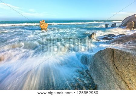 Raging waves hitting reefs create waves splashing up high and dangerous but very beautiful watch, blue sea attracting tourists to resort in central Vietnam coast