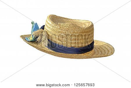 The straw hat decorated with a bow ears and a tape isolated on white