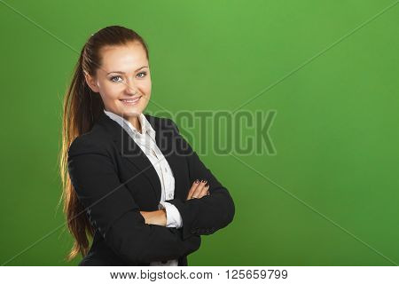 Cheerful business woman on green background. Stock photo.