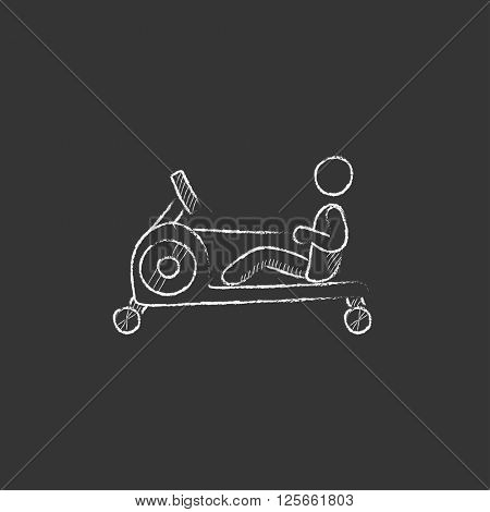 Man exercising with gym apparatus. Drawn in chalk icon.