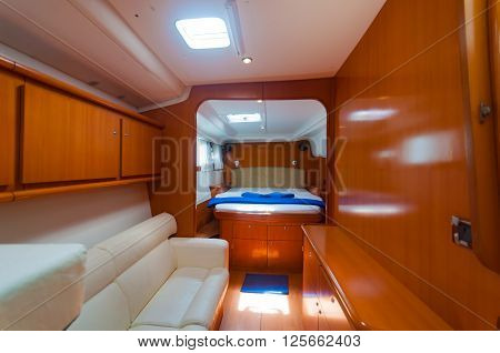 Bed and funiture in a luxury yacht boat decoration