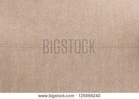 Bege towel fabric. Tablecloth texture. Cotton texture closeup background